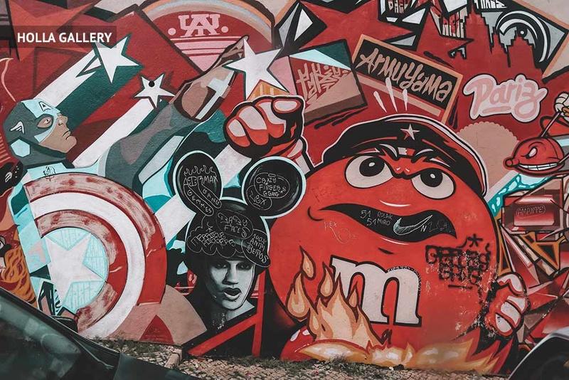 Большое граффити на улице Лиссабона в стиле Шепарда Фейри.