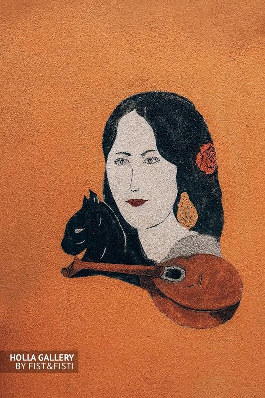 Красивый рисунок девушки на стене улицы Лиссабона.
